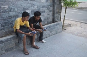 One of the Cambodian locals shares the gospel to his friends