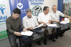 (L-R) Victory Fort Bonifacio Executive Pastor Paolo Punzalan, Victory Philippines Bishop Juray Mora, Habitat for Humanity Philippines CEO & Managing Director Charlie Ayco, and  Bong Recio, Chair of Habitat for Humanity Philippines Board of Trustees, sign the Memorandum of Agreement between Victory and Habitat for Humanity Philippines.