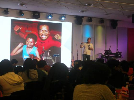 Pastor Ferdie Cabiling shows a photo of his son, Philip, during his message on the Father heart of God.