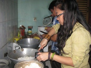 Two of our Ten Days missioners cook up a hearty meal for the locals