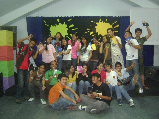 Victory Tarlac students, excited over their ONE 2 ONE booklets